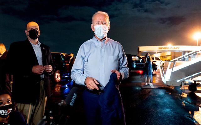 Joe Biden speaks with media before boarding his plane at Tampa International Airport in Tampa, Florida, Oct. 29, 2020. (AP Photo/Andrew Harnik)