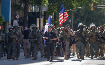 Illustrative: Armed gun rights protesters, led by a member of the far-right Boogaloo boys, march in Richmond, Virginia, August 18, 2020. (Chad Martin/LightRocket via Getty Images, JTA)