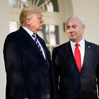 US President Donald Trump, left, and Prime Minister Benjamin Netanyahu walk to a meeting in the Oval Office of the White House in Washington, January 27, 2020. (AP Photo/ Evan Vucci)