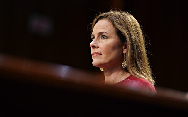 US Supreme Court nominee Amy Coney Barrett listens during a confirmation hearing before the Senate Judiciary Committee on Capitol Hill in Washington, October 13, 2020. (Stefani Reynolds/Pool via AP)