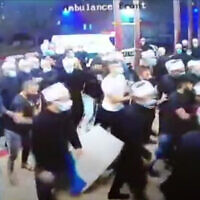 Druze Israelis break into Ziv Medical Center in Safed to snatch the body of Sheikh Abu Zain Al-Din Hassan Halabi on October 30, 2020. (Screenshot/YouTube)