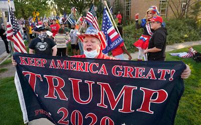 A supporter of US President Donald Trump before the vice presidential debate between Vice President Mike Pence and Sen. Kamala Harris, at the University of Utah in Salt Lake City, Oct. 7, 2020. (AP Photo/Rick Bowmer)