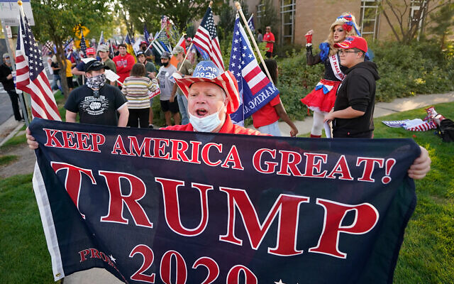 A supporter of US President Donald Trump before the vice presidential debate between Vice President Mike Pence and Sen. Kamala Harris, at the University of Utah in Salt Lake City, Oct. 7, 2020. (AP Photo/Rick Bowmer)