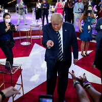 US President Donald Trump leaves after an NBC News Town Hall in Miami, Oct. 15, 2020. (AP Photo/Evan Vucci)