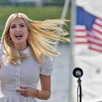 Ivanka Trump, daughter and adviser to US President Donald Trump, removes her mask as she takes the stage before a campaign event in Sarasota, Florida, October 27, 2020. (AP Photo/Chris O'Meara)
