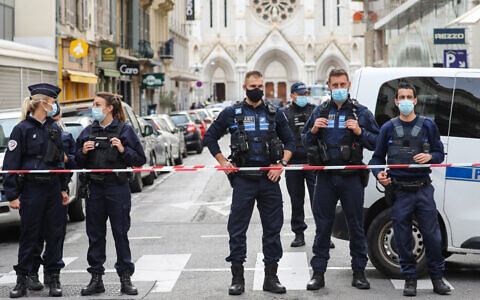 French police block the access to the Notre-Dame de l'Assomption Basilica in Nice on October 29, 2020 after a knife-wielding man killed three people at the church. (Valery Hache/AFP)