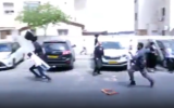 A police officer (R) throws a bucket at a boy during a protest in Beitar Illit, October 4, 2020. (Screenshot: Twitter)