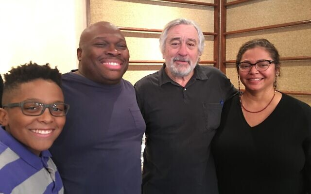 Robert De Niro, center, with 'The War With Grandpa' executive producers, from left, Tre, Marvin, and Rosa Peart. (Courtesy 101 Studios)