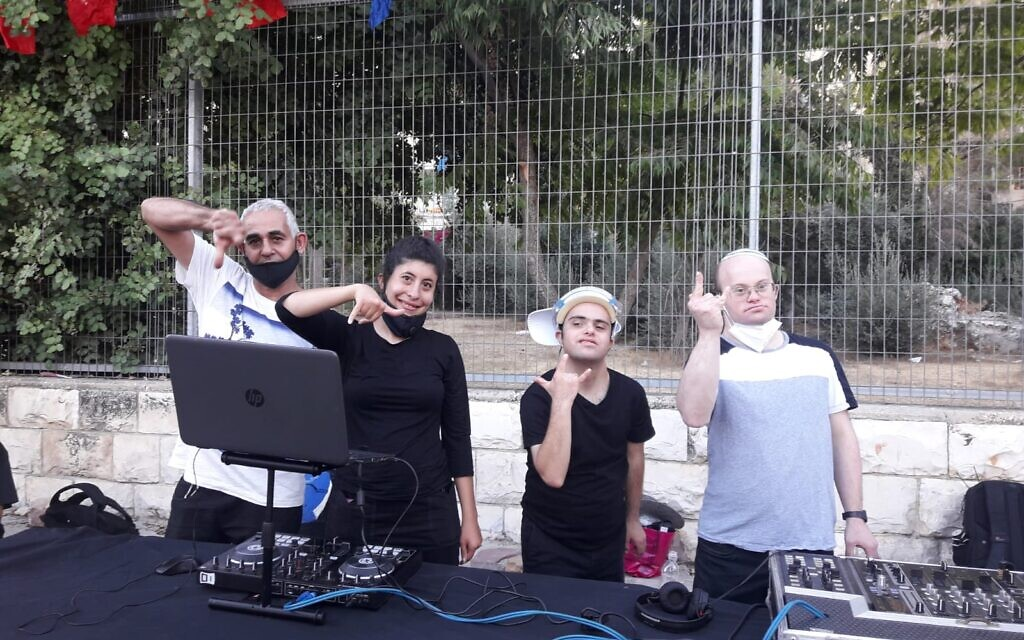 Noam Yomtovyan (second from right) and some of his fellow Special DJs performing for assisted living facilities and coronavirus hotels in Jerusalem on October 7, 2020 (Courtesy Tzamid)