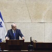Prime Minister Benjamin Netanyahu addresses the Knesset ahead of a vote on ratifying Israel's normalization agreement with the United Arab Emirates (Gideon Sharon/Knesset Spokesperson)