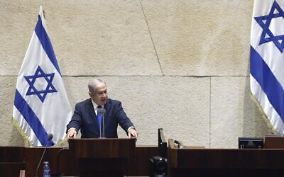 Prime Minister Benjamin Netanyahu addresses the Knesset on October 15 ahead of a vote on ratifying Israel's normalization agreement with the United Arab Emirates (Gideon Sharon/Knesset Spokesperson)