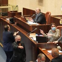 Coalition whip Miki Zohar pleads his case to Deputy Knesset Speaker Mansour Abbas in the plenum on October 21, 2020. (Shmulik Grossman/Knesset)