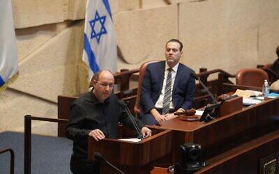 Blue and White Justice Minister Avi Nissenkorn, left, speaks at the Knesset plenum as coalition whip Miki Zohar (Likud) looks on, on October 28, 2020. (Shmulik Grossman/Knesset)