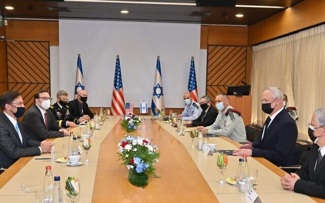 Defense Minister Benny Gantz, right, and senior Israeli defense officials meet with  US Secretary of Defense Mark Esper, left and his staff at military headquarters in Tel Aviv on October 29, 2020. (Ariel Hermoni/Defense Ministry)