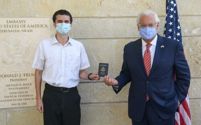 Menachem Zivotofsky (L) is handed the first US passport to have 'Israel' labeled as a place of birth by US Ambassador to Israel David Friedman on October 30, 2020. (US Embassy in Jerusalem)