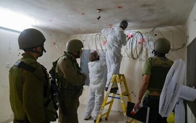 IDF troops seal off room of a Palestinian man suspected of killing a soldier earlier this year, in the town of Yabed on October 21, 2020. (Israel Defense Forces)