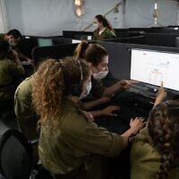 IDF soldiers perform contact tracing for coronavirus patients. (Israel Defense Forces)
