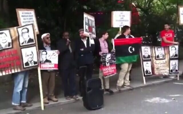 Manchester bomber Salman Abedi (far right, red shirt) attends protest outside the UAE embassy in London, hours after he demonstrated against visit by Prime Minister Benjamin Netanyahu in 2015 (Screen grab/Daily Mail)