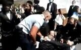 Police in Beit Shemesh in conflict with ultra-Orthodox men on October 6, 2020. (video screenshot)