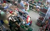 Security footage shows man apologetically robbing Bat Yam grocery store, October 11, 2020 (Screen grab/Channel 12)