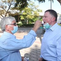 Health Minister Yuli Edelstein is administered a fast coronavirus test during a demonstration at Sheba Medical Center on October 7, 2020 (Oded Karni/GPO)