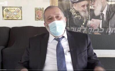 Screen capture from video of Interior Minister Aryeh Deri denying that he had broken coronavirus lockdown travel restrictions on Yom Kippur, October 6, 2020. (Twitter)