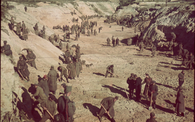 After the mass murder of more than 33,000 Jews at Babyn Yar, Germans and Ukrainians walk atop the mass grave (public domain)