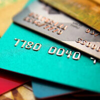 An illustrative image of a stack of multicolored credit cards (alexialex; iStock by Getty Images)
