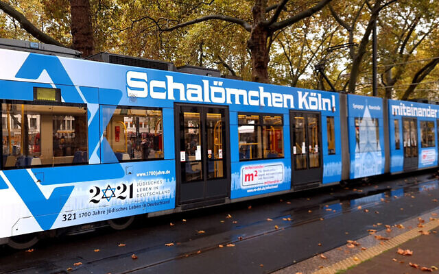 A tram featuring Star of David stickers pulls up to a halt in Cologne, Germany, October 21, 2020. (Courtesy of Synagogue Community Cologne via JTA)