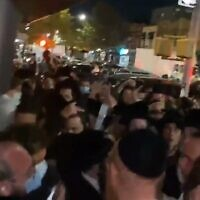 Jewish Insider reporter Jacob Kornbluh (bottom left) is surrounded by dozens of ultra-Orthodox protesters in Brooklyn, New York, on October 7, 2020. (screencapture/ Twitter)