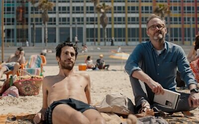 Niv Nissim (left) and John Benjamin Hickey in Eytan Fox's new film, 'Sublet,' the opening film of the rescheduled digital Jerusalem Film Festival, opening December 10, 2020 (Courtesy Daniel Miller)