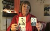 Barbara Brix shows two pictures of her father Peter Kroeger who was part of the 'Einsatzgruppen' Nazi task forces, Schutzstaffel (SS) paramilitary death squads responsible for mass killings, dated 1938 (L) and 1948, in her home in Hamburg, northern Germany, on June 11, 2020 (Marion PAYET / AFP)