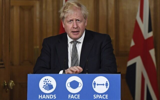 Britain's Prime Minister Boris Johnson speaks during a virtual press conference inside 10 Downing Street in central London on October 31, 2020 to announce new lockdown restrictions in an effort to curb rising infections of the novel coronavirus.  (Alberto Pezzali / POOL / AFP)