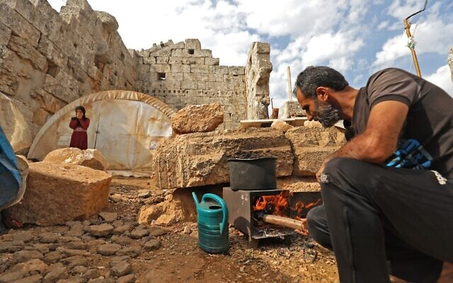Displaced Syrians are pictured on November 1, 2020 in their makeshift camp amid Roman ruins in the area of Baqirha in northwest Syria not far from the Turkish border (Abdulaziz Ketaz / AFP)