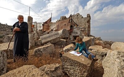 Displaced Syrians are pictured on November 1, 2020, at the UNESCO-listed site of Baqirha not far from the Turkish border, in a region of northwest Syria filled with abandoned Roman and Byzantine settlements (Abdulaziz ketaz / AFP)