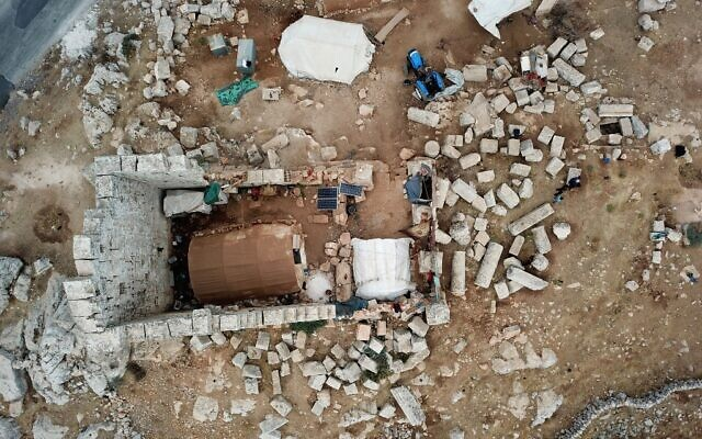 An aerial view shows a makeshift camp of displaced Syrians on November 1, 2020 at Byzantine ruins in the area of Baqirha not far from the Turkish border, in a region of northwest Syria filled with abandoned Byzantine settlements called the Dead Cities, some of which are UNESCO-listed. (Abdulaziz Ketaz / AFP)