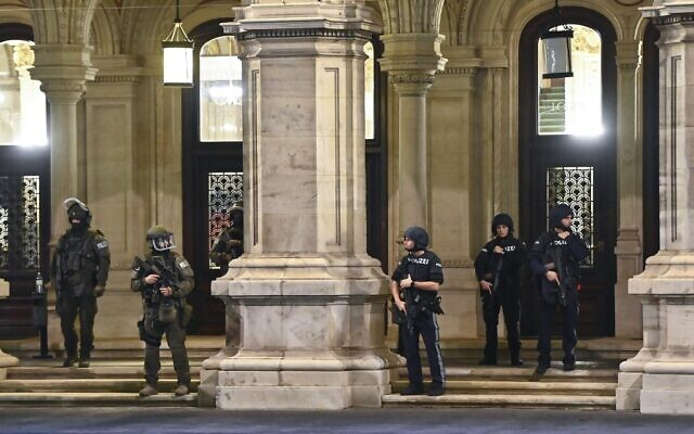Armed policemen stand guard in front of the main entrance of the State Opera in the center of Vienna on November 2, 2020, following a shooting. (Photo by Joe Klamar / AFP)