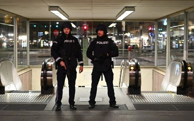 """Armed policemen patrol near the state opera in the center of Vienna on November 2, 2020, following a shooting. - Two people, including one attacker, have been killed in a shooting in central Vienna, police said late November 2, 2020. Vienna police said in a Twitter post there had been """"six different shooting locations"""" with """"one deceased person"""" and """"several injured"""", as well as """"one suspect shot and killed by police officers"""". (Photo by Joe Klamar / AFP)"""