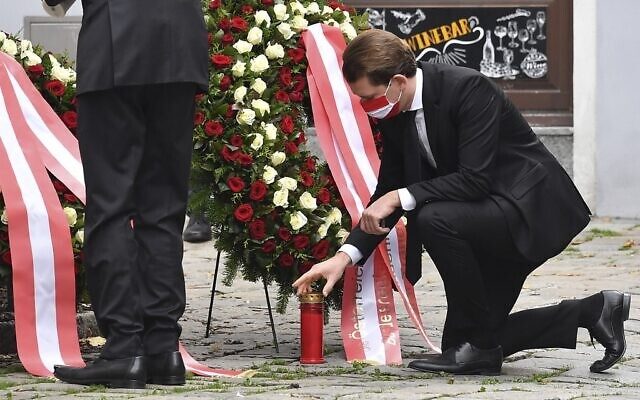 Austrian Chancellor Sebastian Kurz places a candle at a crime scene as he pays his respects to the victims of a shooting in Vienna on November 3, 2020 (JOE KLAMAR / AFP)