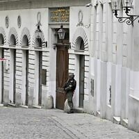 An armed policeman stands guard in front of the synagogue in Seitenstettengasse in Vienna on November 3, 2020, one day after the shootings nearby and at multiple locations across central Vienna. (Hans Punz/APA/AFP)