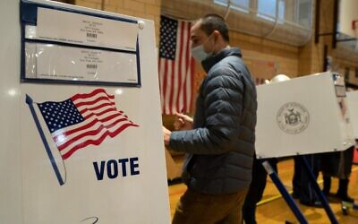 People vote at Public School 33 in New York City on US Election Day, November 3, 2020. (Bryan R. Smith / AFP)