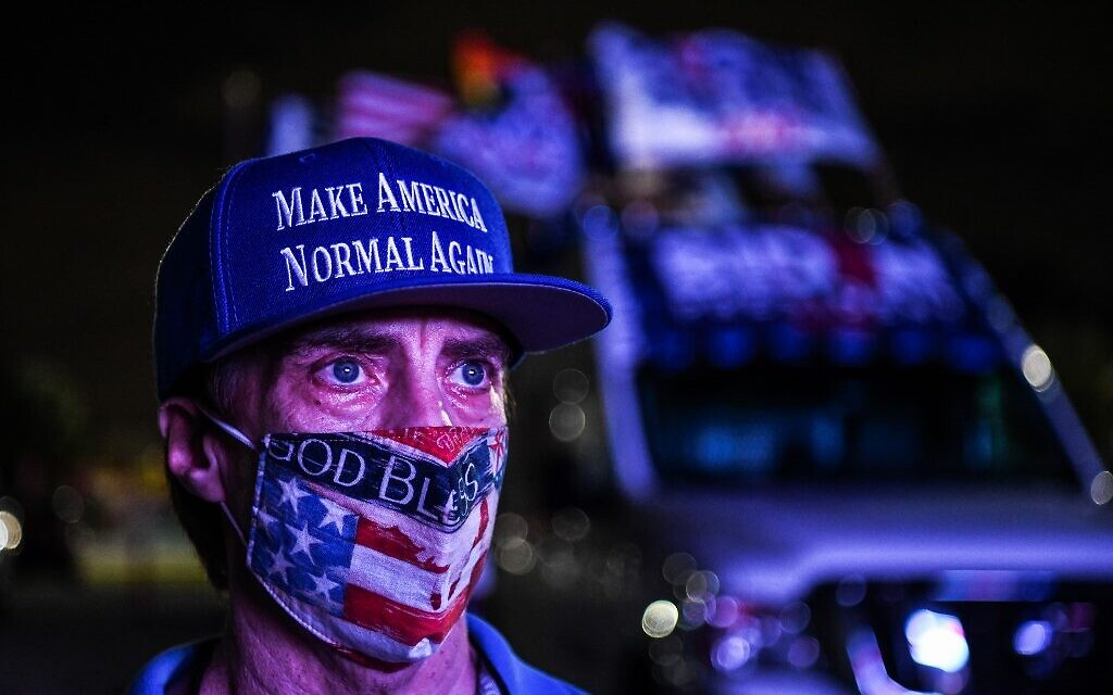 Andy Soberon a supporter of the Democratic party attends a watch party in Miami, Florida on November 3, 2020. (CHANDAN KHANNA / AFP)