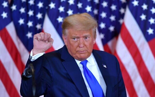 US President Donald Trump pumps his fist after speaking during election night in the East Room of the White House in Washington, DC, early on November 4, 2020. (MANDEL NGAN / AFP)