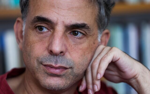 Israeli writer and artist Etgar Keret during an interview with AFP at his home in Tel Aviv on November 5, 2020. (Photo by EMMANUEL DUNAND / AFP)