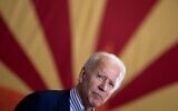 In this file photo taken on October 8, 2020 Democratic presidential candidate former US Vice President Joe Biden pauses while speaking to supporters in front of an Arizona state flag, at the United Brotherhood of Carpenters and Joiners of America's training center in Phoenix, Arizona. (Brendan Smialowski / AFP)