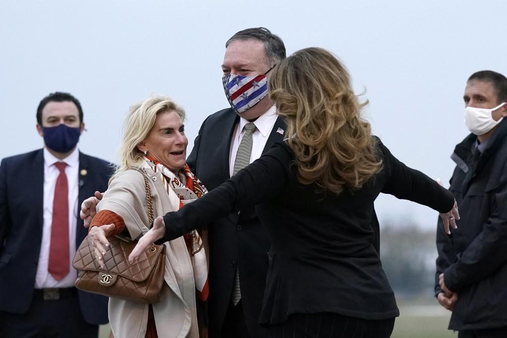 Macron hosts Trump loyalist Pompeo after congratulating Biden