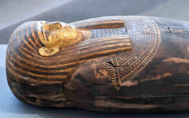 A wooden sarcophagus during the unveiling of an ancient treasure trove of more than a 100 intact sarcophagi, at the Saqqara necropolis 30 kms south of the Egyptian capital Cairo, on November 14, 2020 (Ahmed HASAN / AFP)