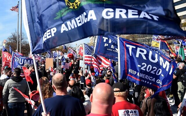 Supporters of US President Donald Trump rally in Washington, DC, on November 14, 2020. (Olivier DOULIERY / AFP)