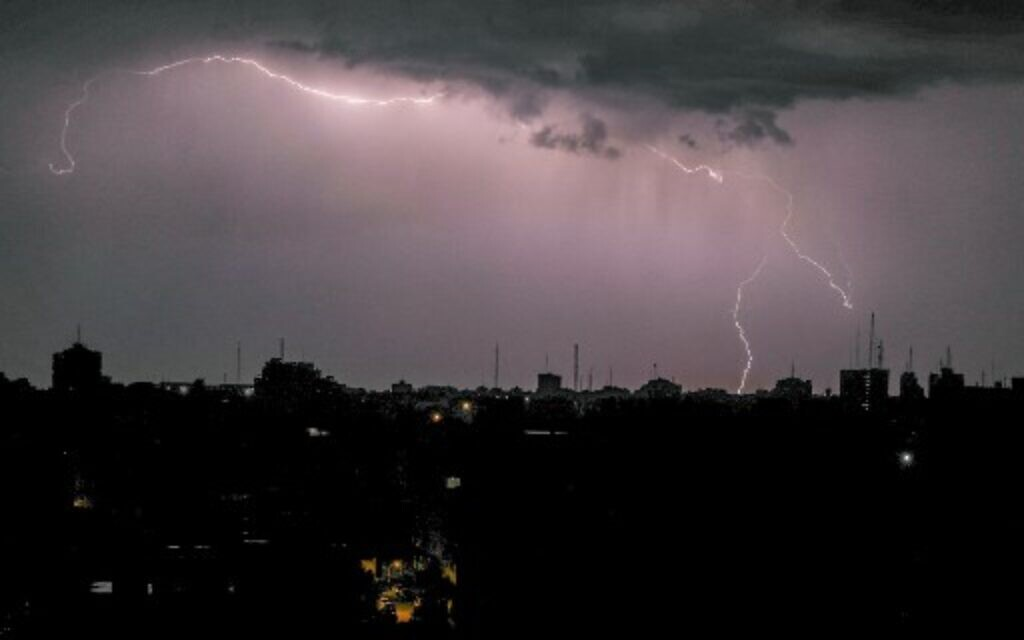 Lightning above buildings during a thunderstorm in Gaza City, on November 15, 2020. (Mahmud Hams / AFP)