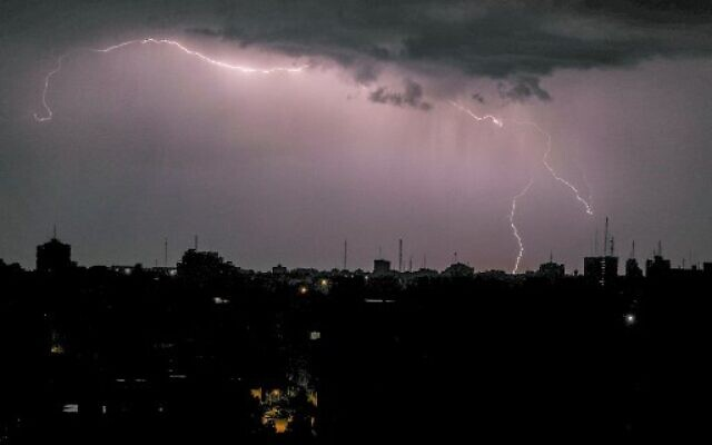 Lightning above buildings during a thunderstorm in Gaza City, on November 15, 2020. (Mahmud Hams / AFP)